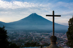 Cerro de la Cruz over Antigua valley opposing volcano Agua. In Guatemala stock photos