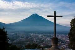 Cerro de la Cruz over Antigua valley opposing volcano Agua. In Guatemala Stock Photos