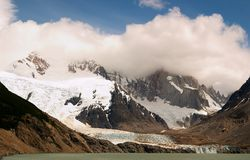 Cerro Torre. Glacier Lake Cloud Stock Photo