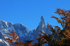 Cerro Torre mountain in autumn colors. Los Glaciares National park, Argentina, background mountain in focus Stock Photo