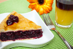 Cerry pie. Slice of delicious homemade cherry pie on white plate stock images