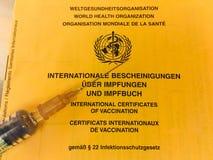 Certificado internacional de la vacunación del WHO fotografía de archivo