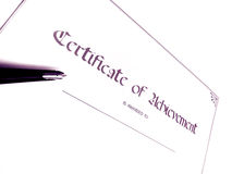 Certificate of achievement. A photograph of a certificate of achievement, taken with a calligraphy pen.  Concept picture for award of cert Royalty Free Stock Photo
