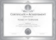 Certificate of achievement template with award ribbon on abstrac Stock Photos