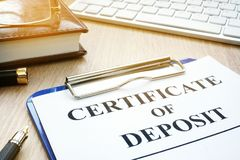 Certificate of deposit on a desk. Certificate of deposit and pen on a desk royalty free stock image