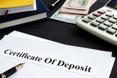 Certificate of deposit and pen in the office. Certificate of deposit and pen in an office stock images