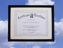 Certificate of Excellence. A certificate floating in the sky Royalty Free Stock Photography