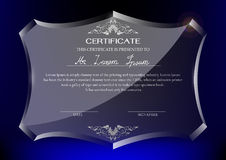 Certificate on glass trophy on dark blue background Royalty Free Stock Photos