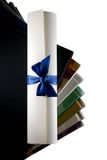 Certificate scroll and books Stock Image
