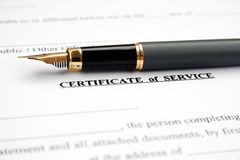 Certificate of service. Fountain pen on certificate of service Stock Images