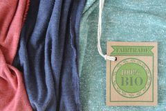 Certified bio organic fabric label. Certified organic bio fabric label. The label is made with recycled paper Royalty Free Stock Images