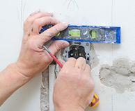 Certified electrician installing socket Royalty Free Stock Images