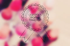 Certified Organic  badge over pink unfocused lipsticks Stock Photography