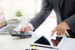 Certified public accountant, Man working on smartphone tablet co. About Certified public accountant, Man working on smartphone tablet computer and spreadsheet stock photos