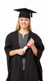Certifikat för studentIn Graduation Gown innehav Royaltyfria Bilder