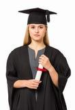 Certifikat för studentIn Graduation Gown innehav Arkivfoton