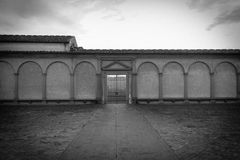 Certosa di Galluzzo di Firenze entrance, inner courtyard. Italy. Photo in black and white color style. Vignette effect. royalty free stock photography