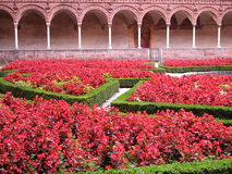 Certosa di Pavia, Italy. Cloister and flowers, Certosa di Pavia, Italy royalty free stock photos
