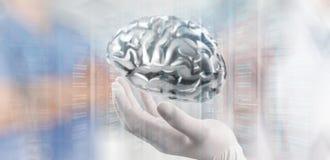 Cerveau en métal d'exposition de main de neurologue de docteur photographie stock libre de droits