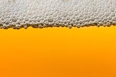 Cerveja com espuma Macro Imagem de Stock Royalty Free