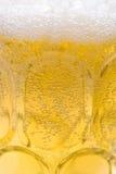 Cerveja da espuma Fotos de Stock Royalty Free