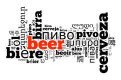 Cerveja da palavra em línguas diferentes Fotografia de Stock Royalty Free