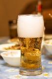 Cerveja na tabela Imagem de Stock