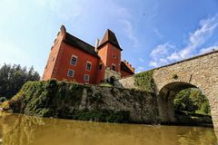 Cervena-Lhota castle with entry bridge from below. On summer day stock photos
