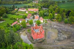 Cervena Lhota in Czech Republic. Cervena Lhota chateau. It stands at the middle of a lake on a rocky island. Its picturesque Renaissance building is a stock image
