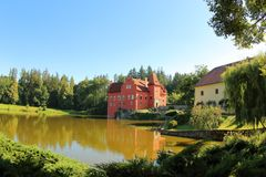 Cervena Lhota, Czech Republic. The red water castle, Cervena Lhota, South Bohemia, Czech Republic. A picturesque Renaissance building surrounded by water stock photo