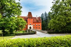 Cervena Lhota - the red, water chateau in the the Czech republic. The red, water chateau in the the Czech republic - Cervena Lhota stock photography