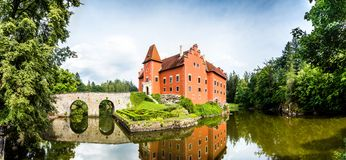Cervena Lhota - the red, water chateau in the the Czech republic. The red, water chateau in the the Czech republic - Cervena Lhota royalty free stock photography