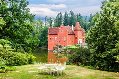 Cervena Lhota - the red, water chateau in the the Czech republic. The red, water chateau in the the Czech republic - Cervena Lhota stock photos