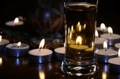 Cerveza con las velas Fotos de archivo libres de regalías