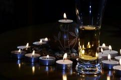 Cerveza con las velas Imagen de archivo libre de regalías