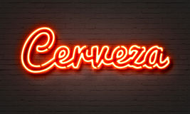 Cerveza neon sign on brick wall background. Cerveza neon sign on brick wall background Stock Photo