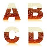 Cerveza oscura ABCD del alfabeto Fotos de archivo