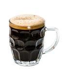Cerveza oscura en blanco Imagenes de archivo