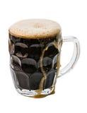 Cerveza oscura en blanco Imagen de archivo