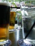 Cerveza y agua imagen de archivo libre de regalías
