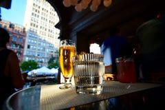Cerveza y agua Fotos de archivo libres de regalías