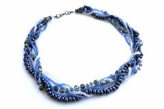 Cervical handmade jewelry in blue shades from beads.  Stock Photo