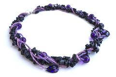 Cervical handmade jewelry in violet shades from beads.  Royalty Free Stock Photo