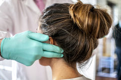 Cervical and headache. Medical doctor visits a young girl suffering cervical and headache Stock Photo