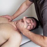 Cervical manipulation. Physical therapist with patient applying cervical manipulation Stock Photos