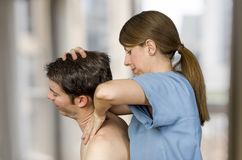 Cervical manipulation with axial compression in a clinic.  royalty free stock photo