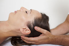 Cervical manipulation close. Cervical manipulation on a female patient Stock Photos