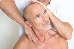 Cervical manipulation. Of an elder patient Stock Photos