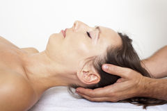 Cervical manipulation. On a female patient Royalty Free Stock Photo