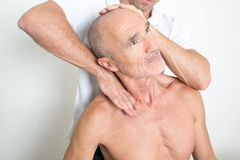 Cervical manipulation with older person Royalty Free Stock Image